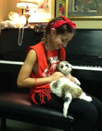 cavachon puppy with girl